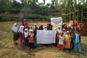 Mi Al-Hidayah students showing their thanks to some of the sponsors who made building the school possible.